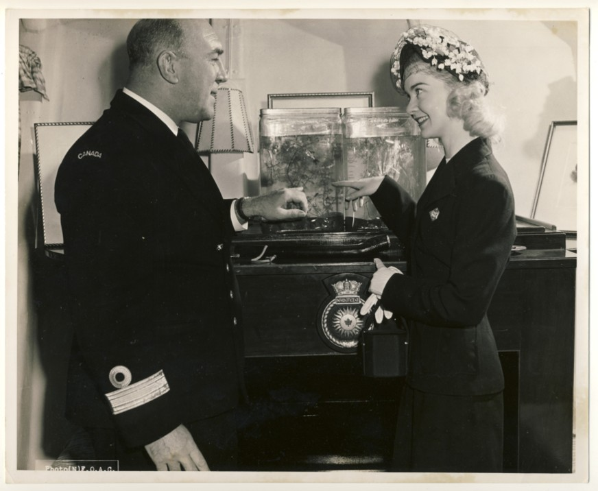 Image for RCN Photograph of Barbara-Ann Scott and Commodore K.F. Adams, on board H.M.C.S. Magnificent, at Halifax, Nova Scotia, Sunday, April 16, 1950