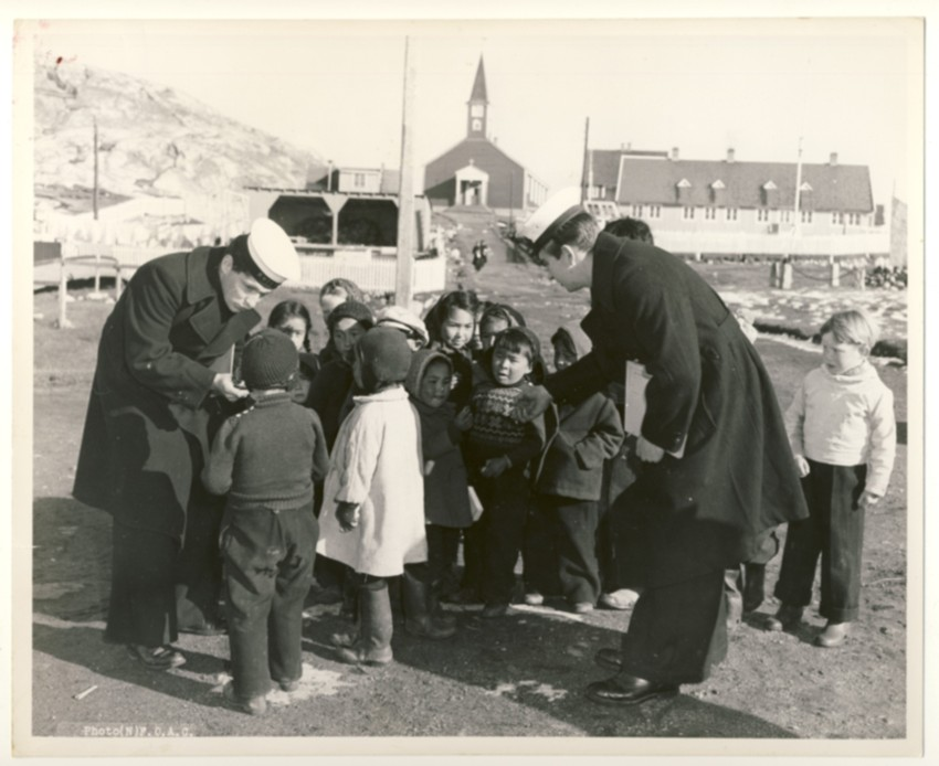 Image for RCN Photograph of Two Canadian Sailors from HMCS Swansea with Children at Nuuk, Greenland, c. 1950