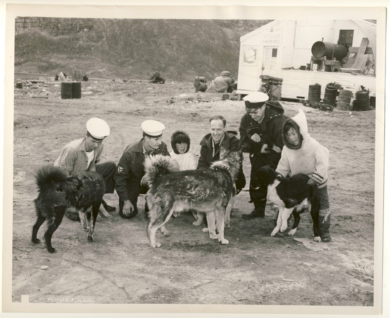 Image for RCN Photograph of Four Canadian Sailors from HMCS Swansea with Inuit Children and Dogs, c. 1950