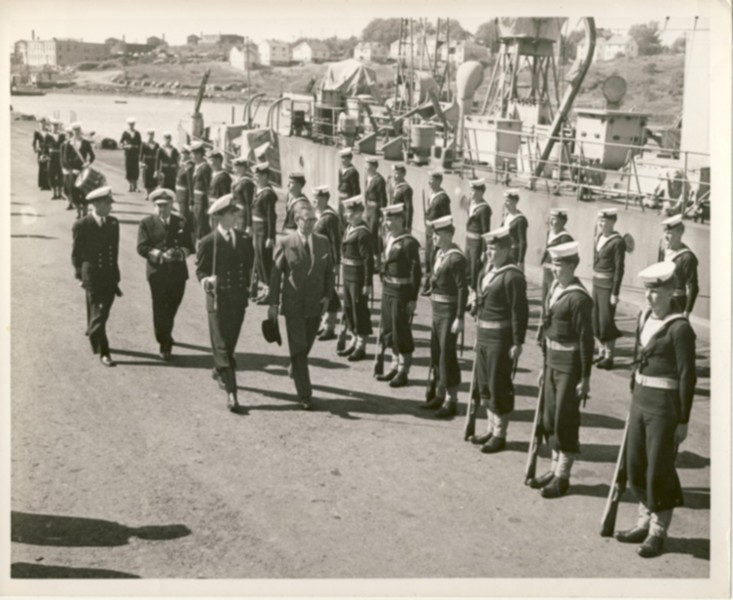 Image for RCN Photograph of Minister of National Defence Brooke Claxton Reviewing Sailors on Parade, c. 1950