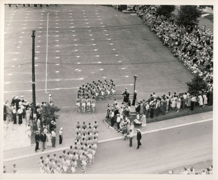 Image for RCN Photograph of the Ceremonies during Navy Week and the Halifax Bicentenary in HMC Dockyard/CFB Halifax,  August 8th to 13th, 1949 [Men entering parade ground for a gymnastic performance]