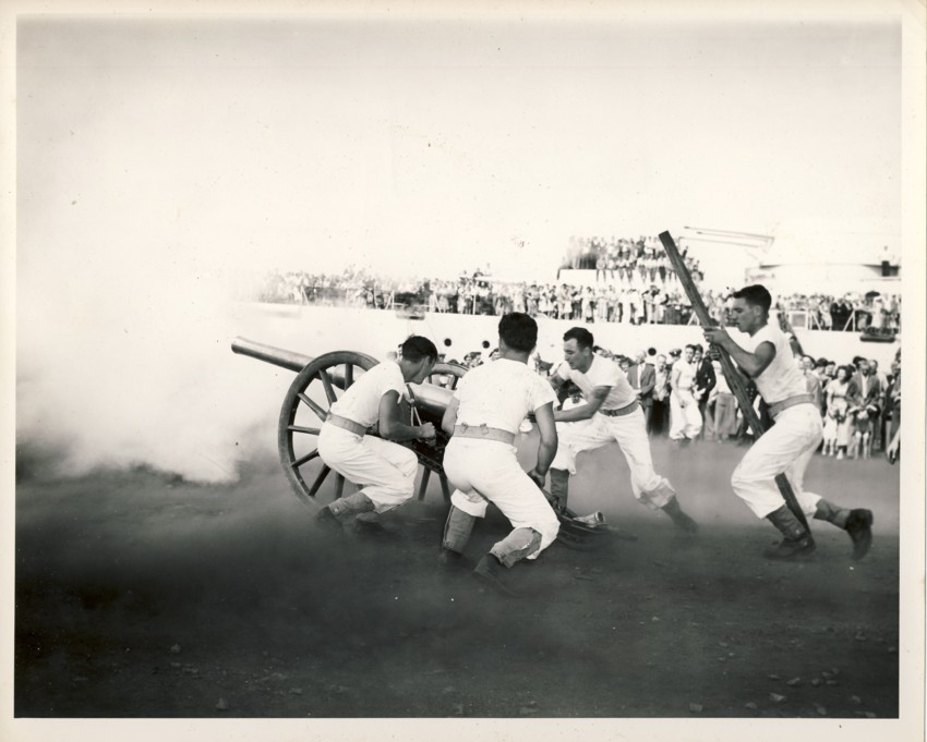 Image for RCN Photograph of the Ceremonies during Navy Week and the Halifax Bicentenary in HMC Dockyard/CFB Halifax,  August 8th to 13th, 1949 [Men in shooting cannon with people in background]