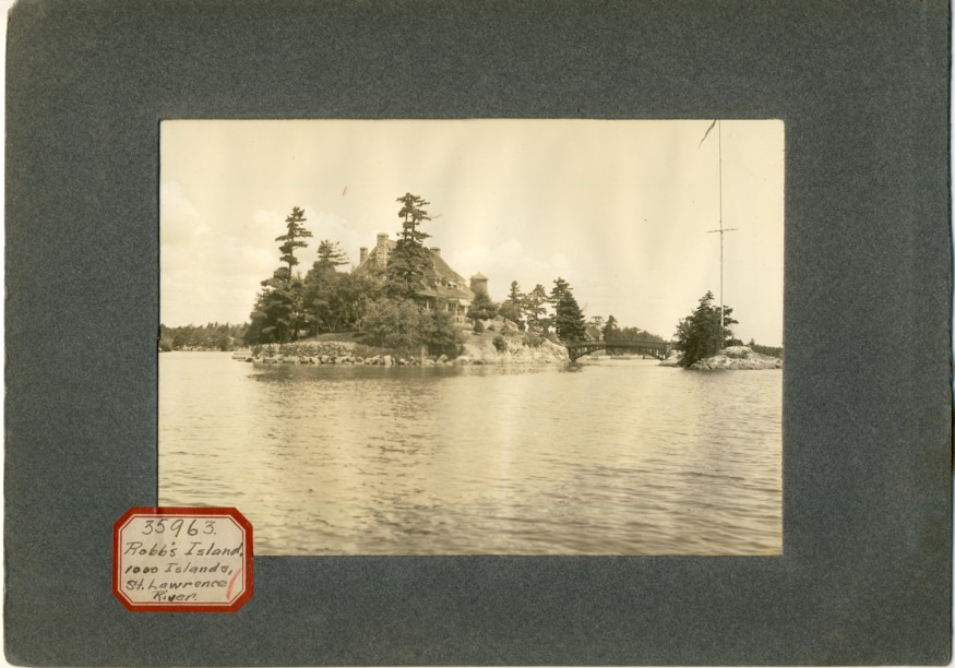 Image for Photograph of Zavikon Island with little international bridge in the St. Lawrence River( Sticker reads Robb's Island , 1000 Island St. Lawrence River)