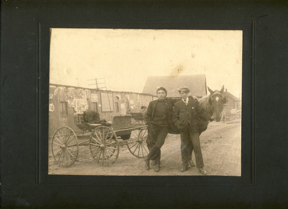 Image for Photograph of Two Young Men in Front of a Horse and Buggy