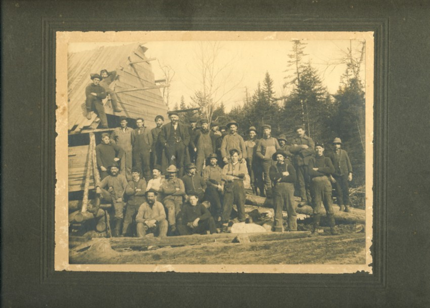 Image for Photograph of Large Group of Lumbermen Beside Partially Build Lodge